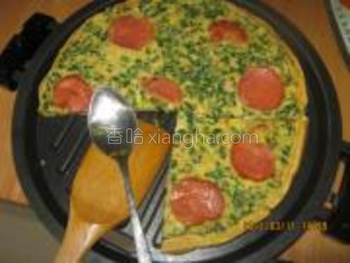 荠菜肉鸡蛋摊好即可。